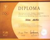 TOK prezidento  A. Samarančo ir tarpt. imtynių federacijos prezidento  Ercegan Milan pasirašytas diplomas P. Abelkiui už žymų indėlį plėtojant imtynių sportą ir olimpizmą bei žmonių draugystės ir solidarumo stiprinimą. 2001. (Originalas -  Klaipėdos sportininkų namų ekspozicijoje)
