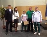Treneriai Vladimiras Audickas ir Olegas Zaicevas, Damianas Matveiko ir Latvijos imtyniu federacijos prezidentas Dzintars Urbanciks su žmona