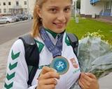 Kamilė Gaučaitė su iškovotu medaliu