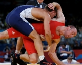 Denmark\'s Mark Overgaard Madsen, red, competes against Lithuania\'s Aleksandr Kazakevic during a 74-kg Greco-Roman wrestling bronze medal match at the 2012 Summer Olympics, Sunday, Aug. 5, 2012, in London. (AP Photo/Paul Sancya)