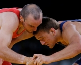 bronze medal match during the 74-kg Greco-Roman wrestling competition at the 2012 Summer Olympics, Sunday, Aug. 5, 2012, in London. (AP Photo/Paul Sancya)