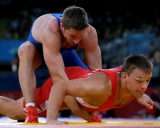 Lithuania\'s Aleksandr Kazakevic, red, competes with Sweden\'s Robert Rosengren during the 74-kg Greco-Roman wrestling competition at the 2012 Summer Olympics, Sunday, Aug. 5, 2012, in London. (AP Photo/Paul Sancya)
